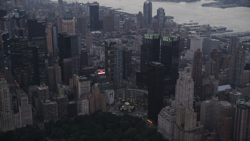 4K stock footage aerial video Flying by Columbus Circle, revealing Times Square, New York, New York, twilight Aerial Stock Footage | AX89_069