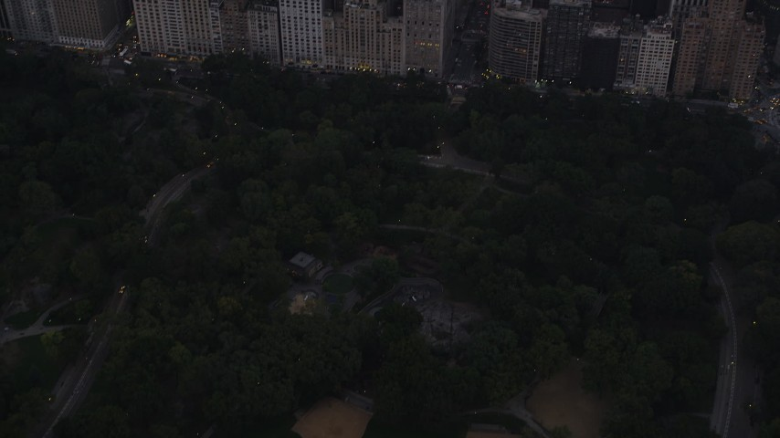 4K stock footage aerial video Fly over Central Park, Times Square, Midtown Manhattan, New York, twilight Aerial Stock Footage | AX89_070