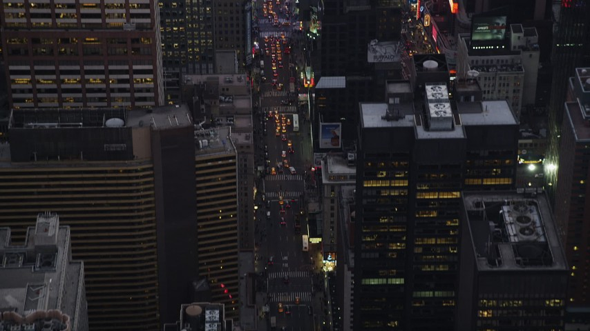 4K stock footage aerial video Fly over 7th Avenue, reveal Times Square, Midtown Manhattan, New York, twilight Aerial Stock Footage | AX89_072
