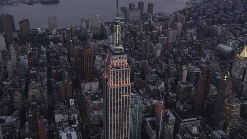 4K stock footage aerial video Flying by the Empire State Building, Midtown Manhattan, New York, twilight Aerial Stock Footage   AX89_076