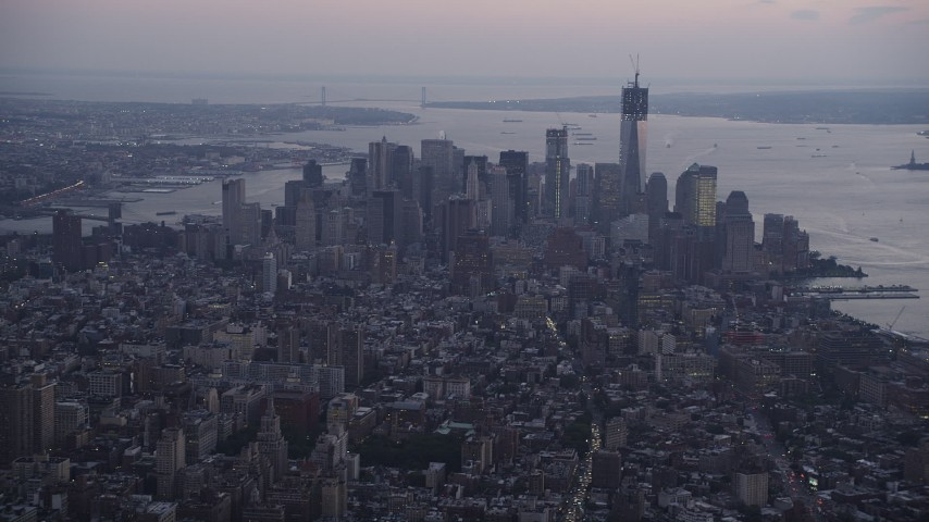 Flying by Lower Manhattan, seen from Midtown, New York, New York, sunset Aerial Stock Footage | AX89_077