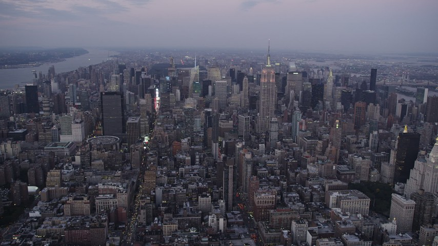 4K stock footage aerial video Approaching Midtown Manhattan, Empire State Building, New York, twilight Aerial Stock Footage | AX89_080