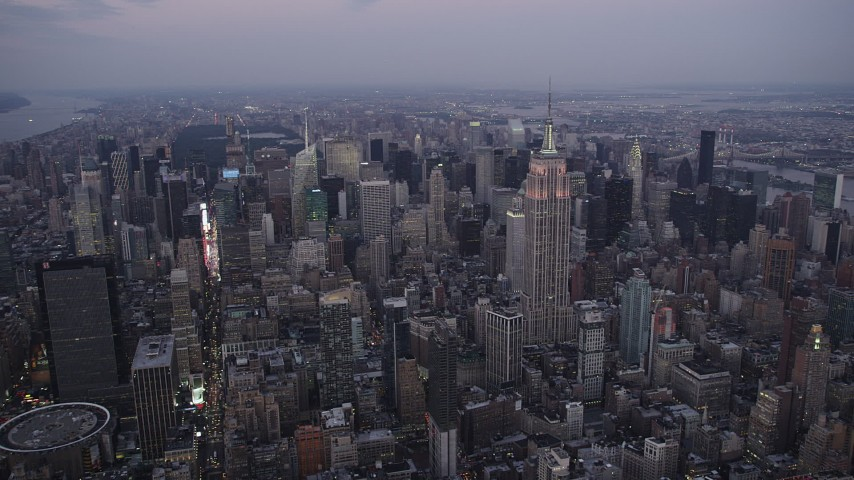 5k aerial video Approaching Empire State Building, Midtown Manhattan, New York, twilight Aerial Stock Footage | AX89_081