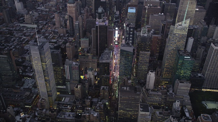 4K stock footage aerial video Approaching Times Square, Midtown Manhattan, tilt down, New York, twilight Aerial Stock Footage | AX89_083