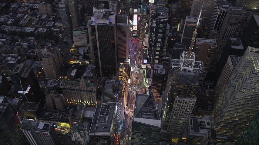 4K stock footage aerial video Approaching Times Square, Midtown Manhattan, tilt down, New York, twilight Aerial Stock Footage | AX89_084
