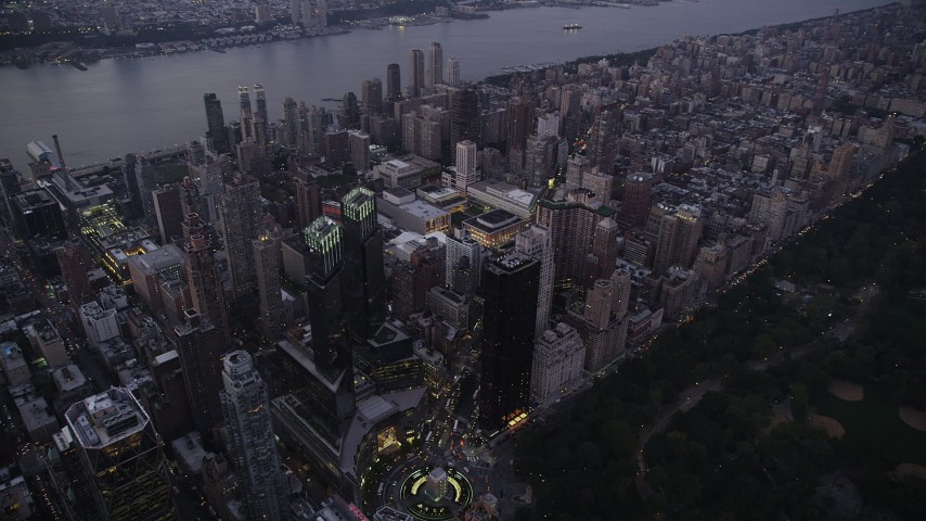 4K stock footage aerial video Flying by skyscrapers, Columbus Circle, Upper West Side, New York, twilight Aerial Stock Footage | AX89_086