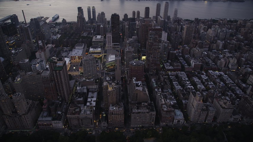 4K stock footage aerial video Flying by skyscrapers, Upper West Side, New York, New York, twilight Aerial Stock Footage | AX89_088