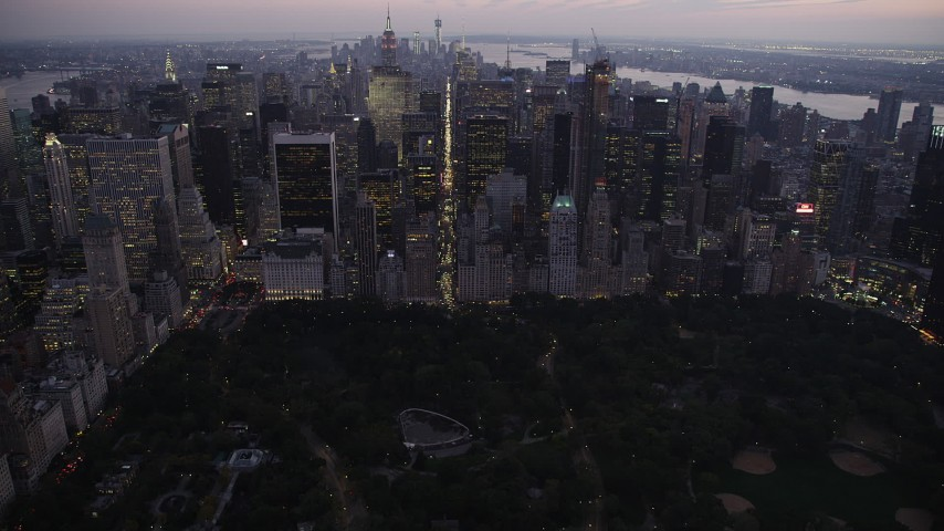 4K stock footage aerial video Approaching Central Park, revealing Midtown Manhattan, New York, twilight Aerial Stock Footage | AX89_091