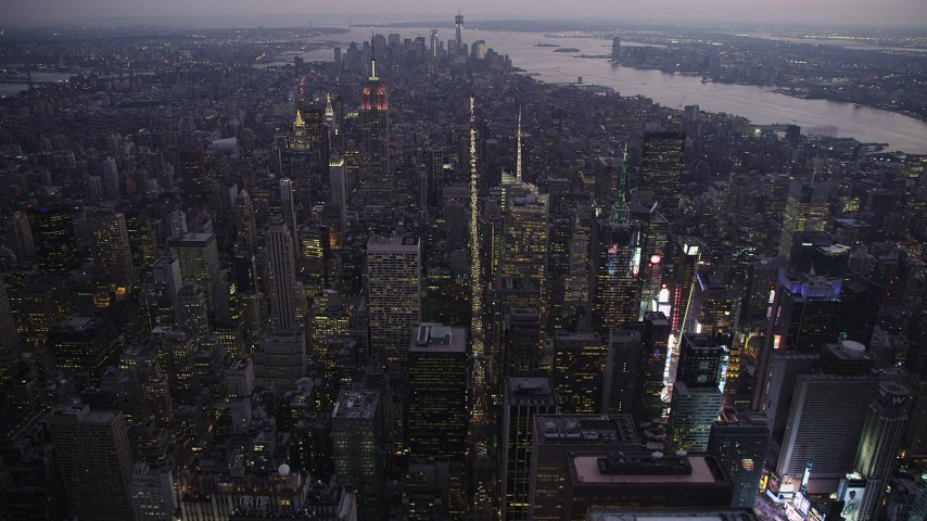 4K aerial video Flying over Midtown Manhattan, approach Empire State Building, New York, twilight Aerial Stock Footage | AX89_095