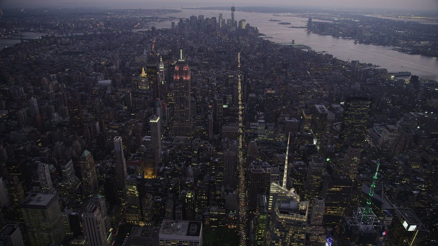 5k aerial video Approaching Empire State Building, Lower Manhattan, New York, twilight Aerial Stock Footage | AX89_096