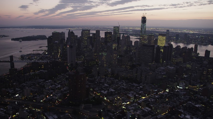 4K stock footage aerial video Flying by Lower Manhattan, seen from Lower East Side, New York, twilight Aerial Stock Footage | AX89_104