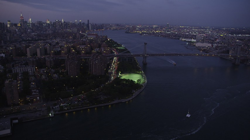 4K stock footage aerial video Approaching the Williamsburg Bridge, Lower East Side, New York, twilight Aerial Stock Footage | AX89_109
