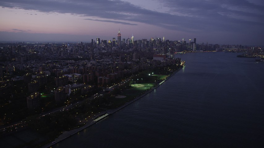 4K stock footage aerial video of Midtown Manhattan, East River, Lower East Side, New York, twilight Aerial Stock Footage | AX89_111