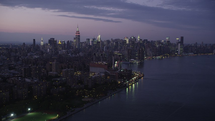 4K stock footage aerial video Approaching Midtown Manhattan, seen from East River, New York, twilight Aerial Stock Footage   AX89_112
