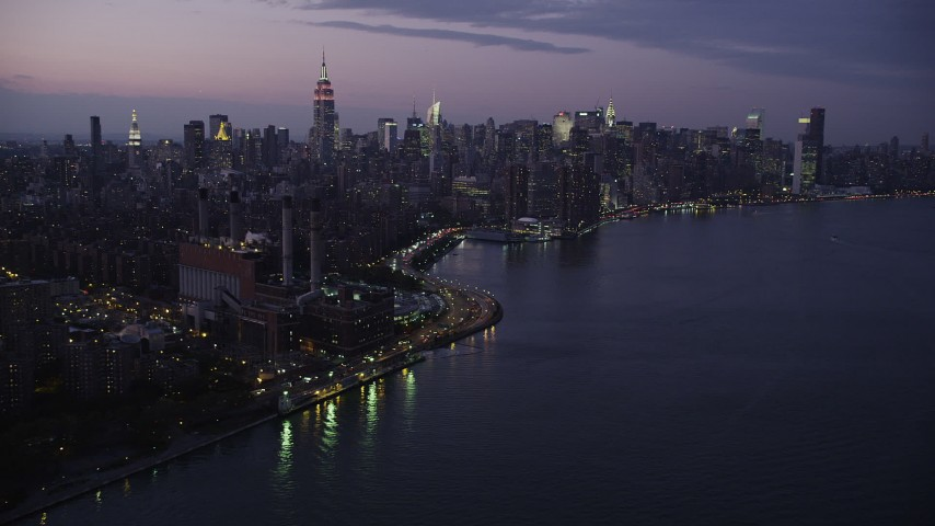4K stock footage aerial video Flying by Midtown Manhattan, seen from East River, New York, New York, twilight Aerial Stock Footage | AX89_113