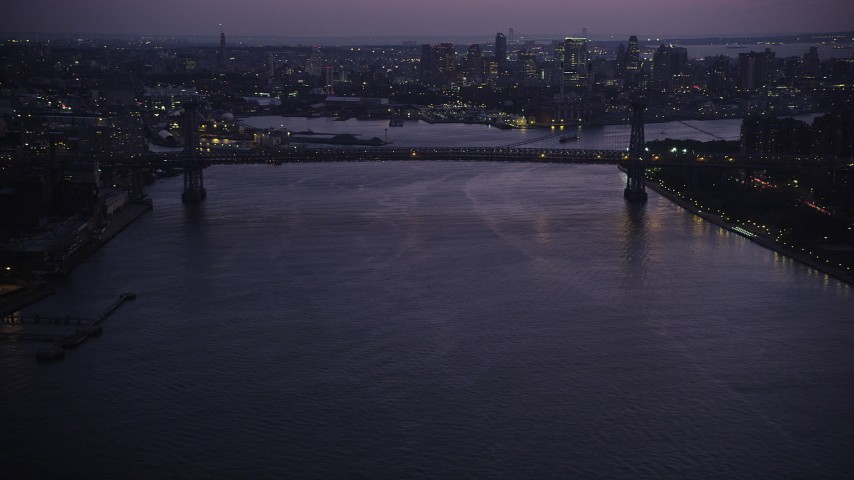 4K stock footage aerial video Approaching the Williamsburg Bridge, East River, New York, New York, twilight Aerial Stock Footage | AX89_116