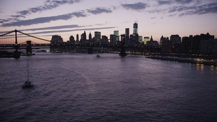 4K stock footage aerial video Flying over East River, Lower Manhattan, Manhattan Bridge, New York, twilight Aerial Stock Footage | AX89_120