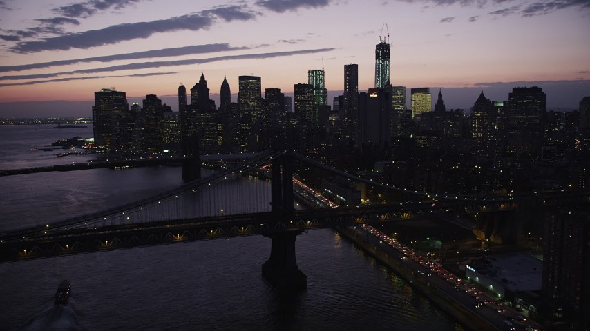 4K stock footage aerial video Flying over Manhattan Bridge, approach Lower Manhattan, New York, twilight Aerial Stock Footage | AX89_122
