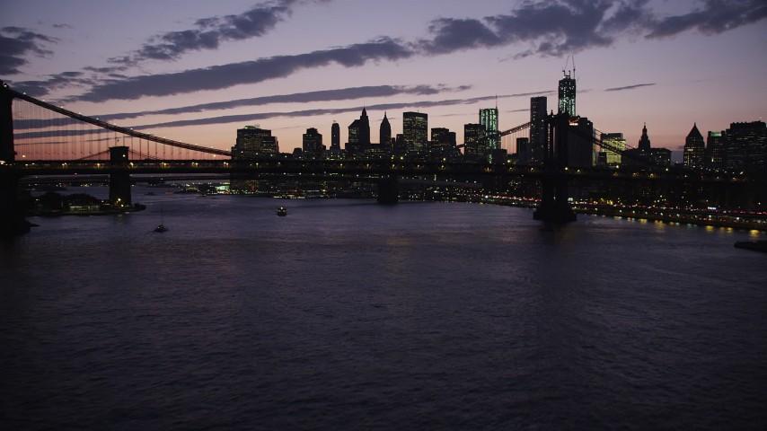 4K stock footage aerial video Flying by Manhattan Bridge, Lower Manhattan skyline, New York, twilight Aerial Stock Footage | AX89_127