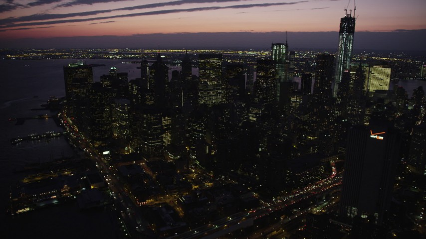 4K stock footage aerial video Approaching Lower Manhattan skyscrapers, tilt down, New York, twilight Aerial Stock Footage | AX89_131