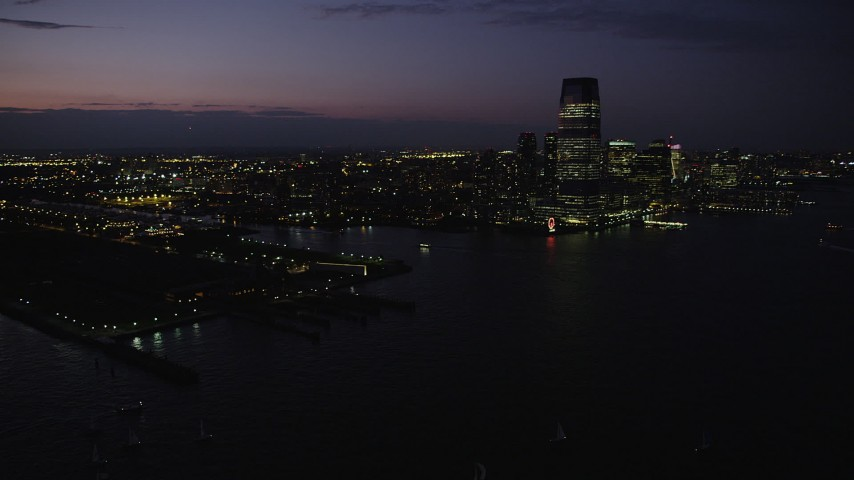 4K stock footage aerial video Panning right to Goldman Sachs Tower, Downtown, Jersey City, New Jersey, twilight Aerial Stock Footage | AX89_136