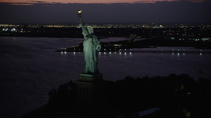 4K stock footage aerial video Flying by Statue of Liberty, Liberty Island, New York, New York, twilight Aerial Stock Footage | AX89_139