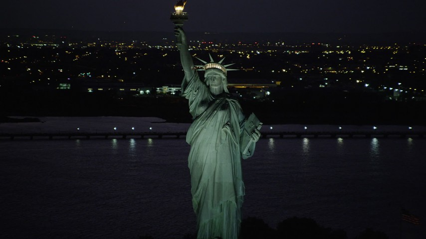 4K stock footage aerial video Flying by Statue of Liberty, Liberty Island, New York, New York, night Aerial Stock Footage | AX89_140