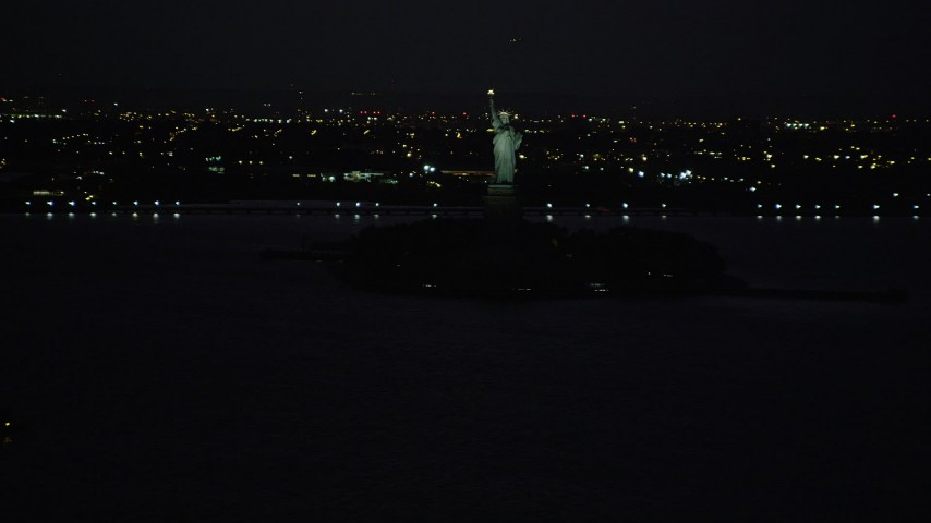 4K stock footage aerial video Approaching Statue of Liberty, Liberty Island, New York, New York, night Aerial Stock Footage | AX89_144