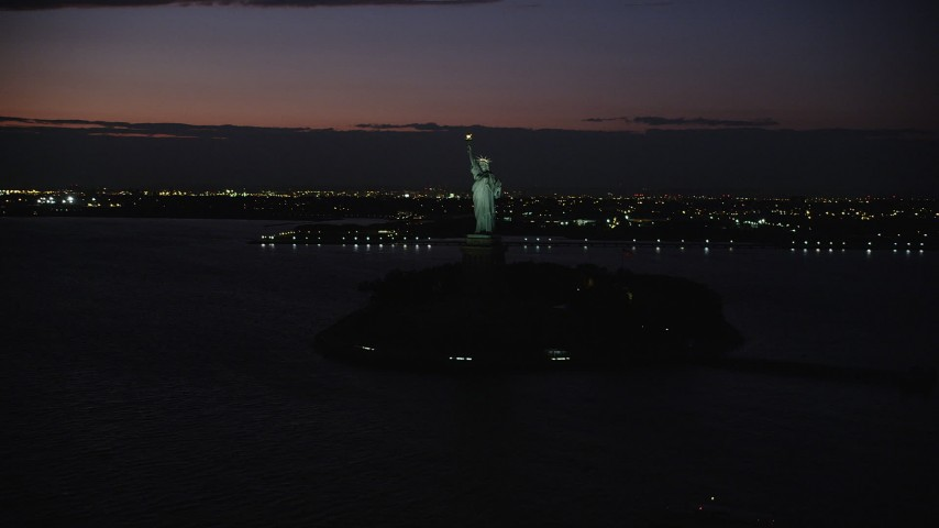 4K stock footage aerial video Flying by Statue of Liberty, Liberty Island, New York, New York, night Aerial Stock Footage | AX89_145