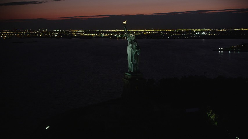 4K stock footage aerial video Flying by Statue of Liberty, Liberty Island, New York, New York, night Aerial Stock Footage | AX89_146