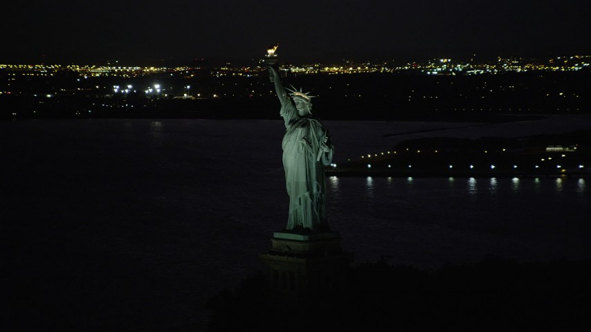 4K stock footage aerial video Flying by Statue of Liberty, Liberty Island, New York, New York, night Aerial Stock Footage | AX89_147