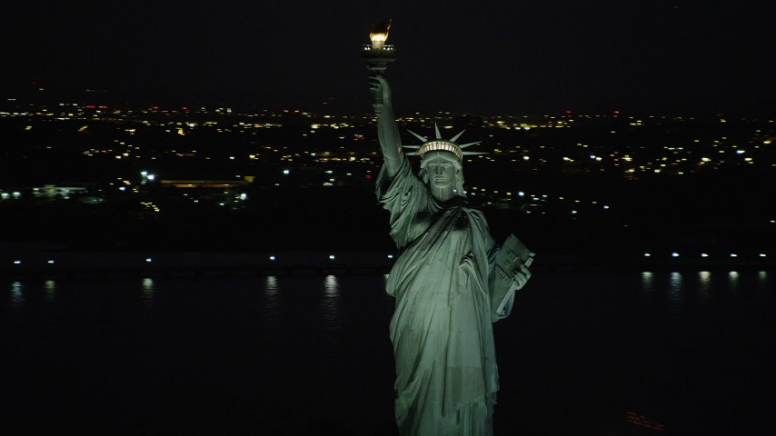 4K stock footage aerial video Flying by Statue of Liberty, New York Harbor, New York, New York, night Aerial Stock Footage   AX89_148