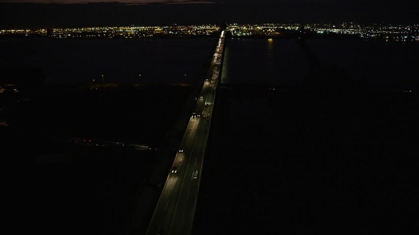 4K stock footage aerial video Flying by Newark Bay Bridge, Newark, New Jersey, night Aerial Stock Footage | AX89_153