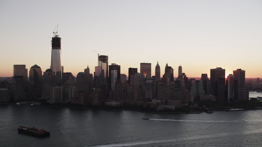 4K stock footage aerial video Approaching Lower Manhattan skyline, New York, New York, sunrise Aerial Stock Footage | AX90_003