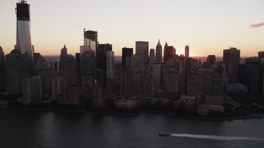 Flying by Lower Manhattan skyline, New York, New York, sunrise Aerial Stock Footage | AX90_004