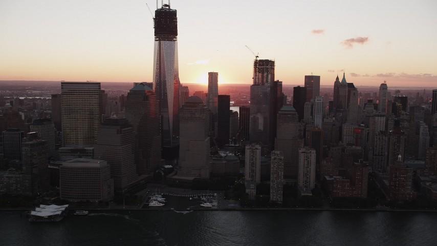 4K stock footage aerial video Flying by World Trade Center, Lower Manhattan, New York, New York, sunrise Aerial Stock Footage | AX90_006