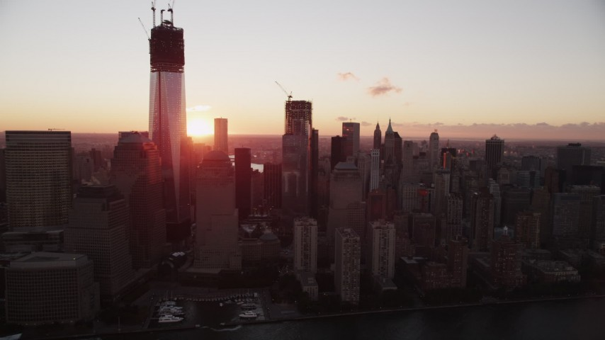 4K aerial video Flying by Lower Manhattan skyscrapers, New York, New York, sunrise Aerial Stock Footage | AX90_009