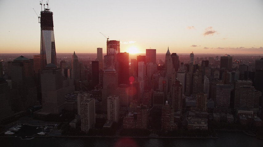 4K stock footage aerial video Flying by Lower Manhattan skyscrapers, New York, New York, sunrise Aerial Stock Footage | AX90_010
