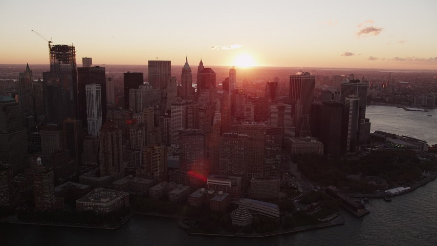 4K aerial video Flying by Lower Manhattan skyscrapers, New York, New York, sunrise Aerial Stock Footage | AX90_011