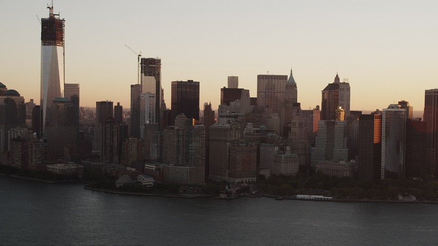 4K stock footage aerial video Flying over New York Harbor, revealing Lower Manhattan, New York, sunrise Aerial Stock Footage | AX90_022