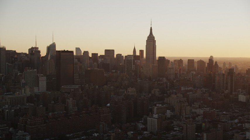 4K stock footage aerial video Flying by Midtown Manhattan, Empire State Building, New York, sunrise Aerial Stock Footage | AX90_028