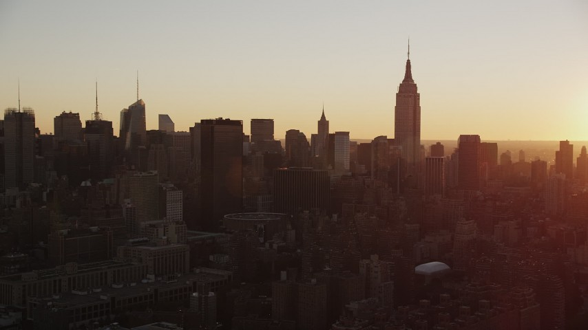 4K stock footage aerial video Flying by Empire State Building, Midtown Manhattan, New York, sunrise Aerial Stock Footage | AX90_029