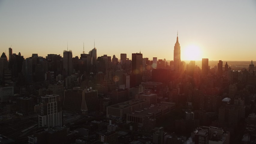 4K stock footage aerial video of the Empire State Building, Midtown Manhattan, New York, New York, sunrise Aerial Stock Footage | AX90_030