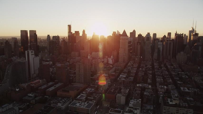 Flying by Midtown Manhattan, New York, New York, sunrise Aerial Stock Footage | AX90_033