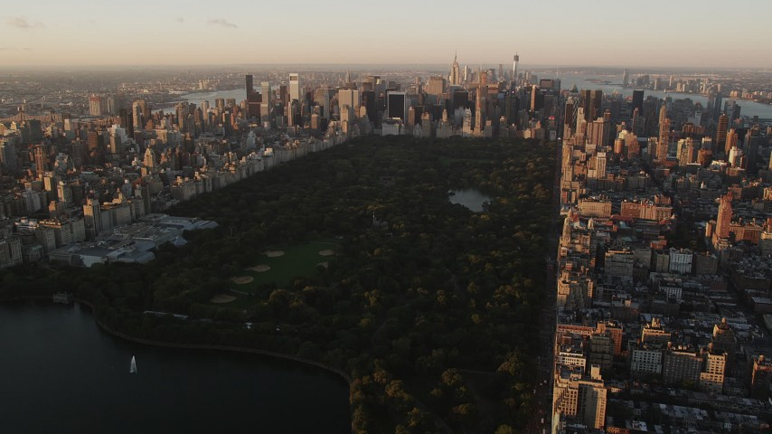 Flying over Central Park, approaching Midtown Manhattan, New York, sunrise Aerial Stock Footage | AX90_040