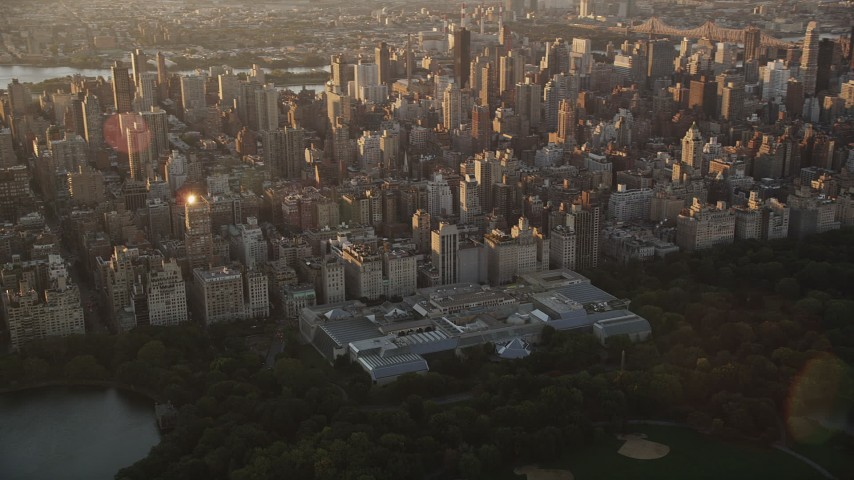 4K stock footage aerial video Flying by the Metropolitan Museum of Art, New York, New York, sunrise Aerial Stock Footage | AX90_041