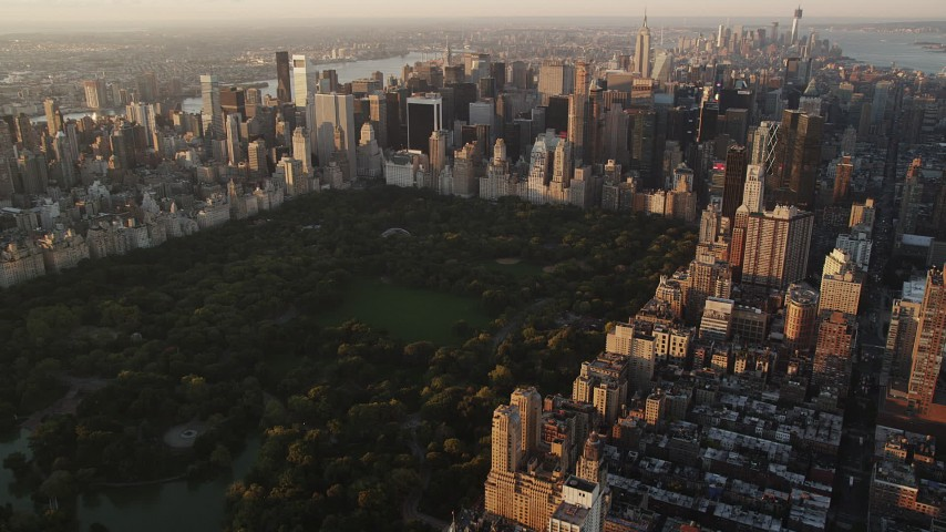 4K stock footage aerial video Flying by Central Park, Midtown Manhattan, New York, New York, sunrise Aerial Stock Footage | AX90_043
