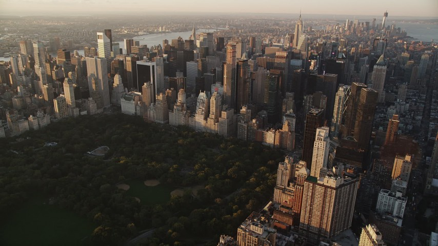 4K aerial video Flying by Midtown Manhattan, New York, New York, sunrise Aerial Stock Footage | AX90_044