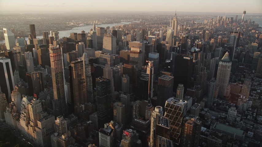 5k aerial video Flying by Midtown Manhattan, New York, New York, sunrise Aerial Stock Footage | AX90_045