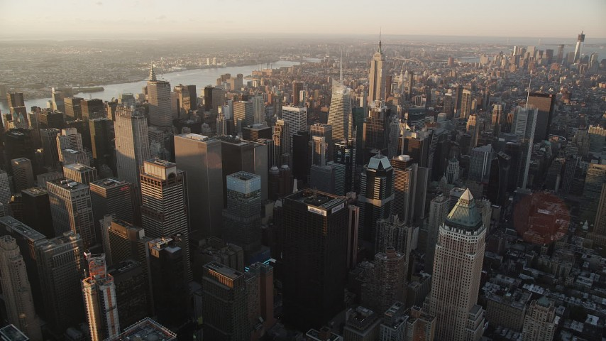 4K stock footage aerial video Flying by Midtown Manhattan, Empire State Building, New York, sunrise Aerial Stock Footage | AX90_046